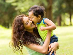 Woman embracing toddler child