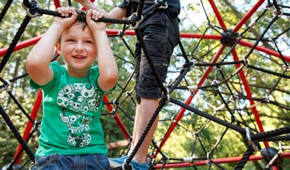 FPO image only - Young boy playing on a playground