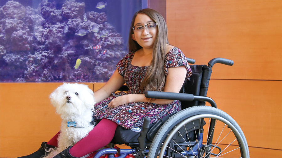 A picture of Shannon with Frosty, her service dog.