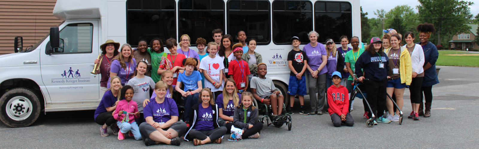 Camp SOAR campers with WIN bus