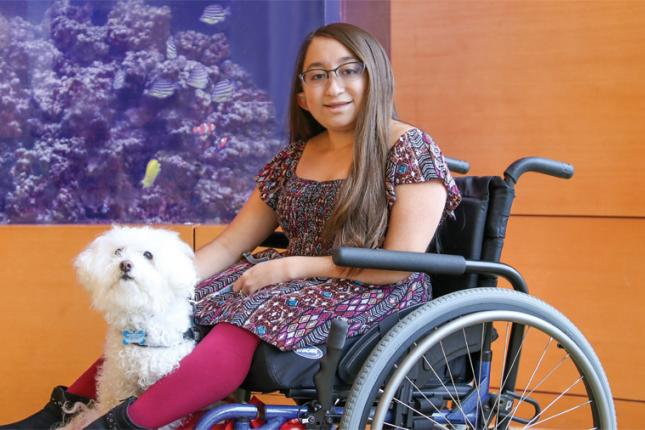 Kennedy Krieger patient Shannon with her service dog, Frosty