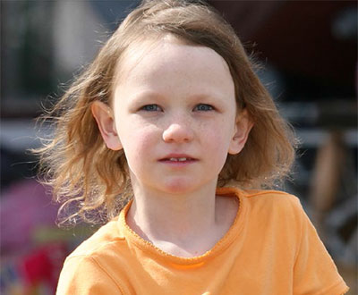 Little girl with orange shirt