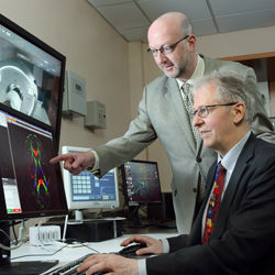 Dr Van Zijl and Pekar viewing a MRI