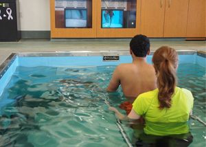 patient and therapist using aquatic treadmill