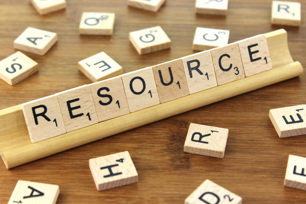 "A photo of a Scrabble board, with the pieces spelling out the word ""Resource"""