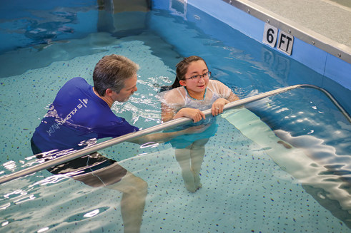 Shannon develops core strength in aquatherapy with physical therapist Christopher Joseph.