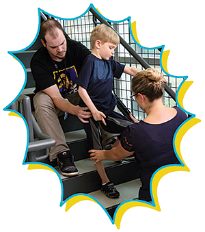 Sebastian works on using his right hand again with Shannon Iuculano, his occupational therapist.