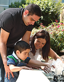 Karam and his parents, Ousama and Dana, visit Kennedy Krieger's therapeutic garden.