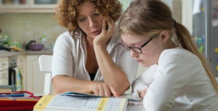 Mother with daughter doing homework