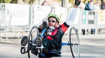 A photo of Jerry, a Kennedy Krieger International Center for Spinal Cord Injury patient, handcycling at the Baltimore Running Festival
