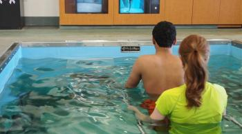 patient and therapist using the aquatic treadmill