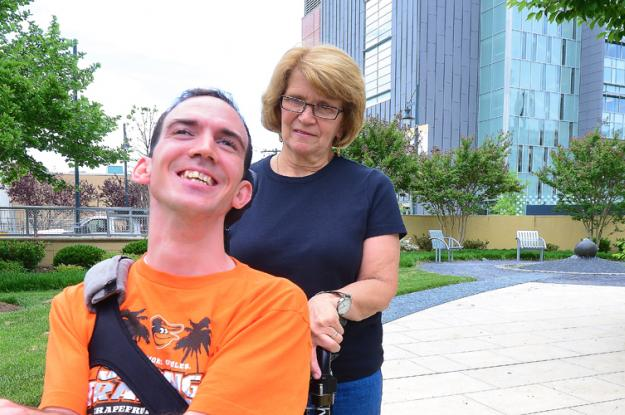 A photo of Kevin DiLegge and his mom on a sidewalk