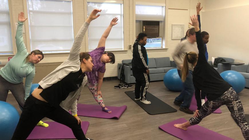 Students participate in yoga