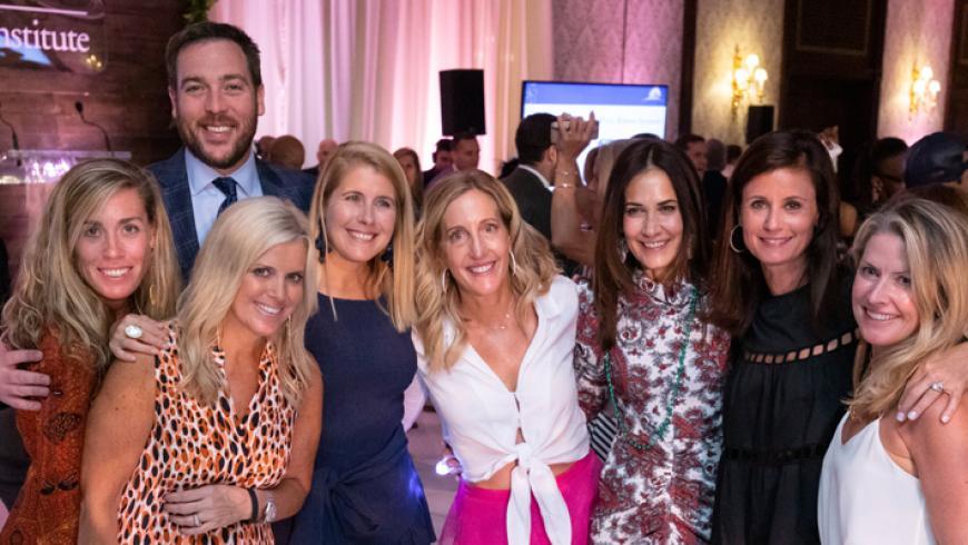 Tiffany Colimore; Peter and Stacy Korzenewski; Pam Ward; Aimee Fulchino,* event co-chair and WIN co-president; Kim Suntha; Virginia Brody; and Kara Bennett* (*Member of WIN)